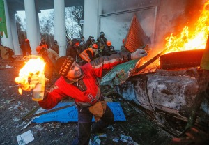 A protester throws a Molotov cocktail during an anti-government protest in downtown Kiev. Source